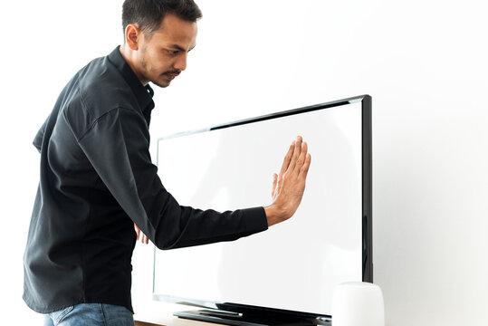 Man touching smart TV screen