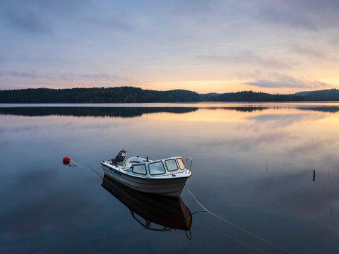 Moored motorboat at lake