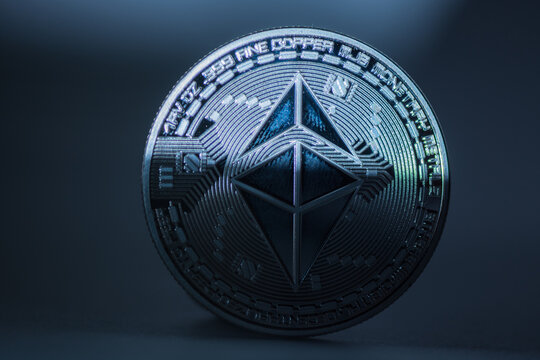 single blue ether coin from ethereum with half shadow