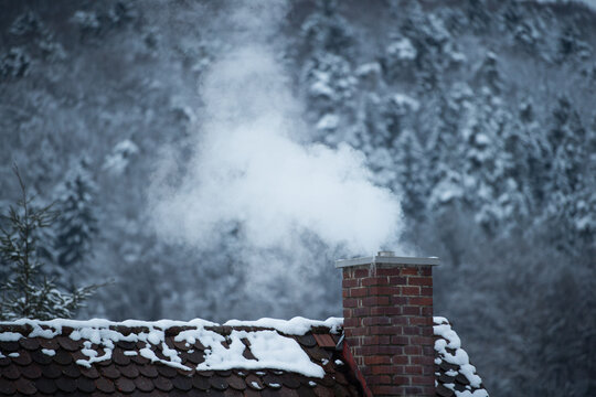 Smoking chimney in winter