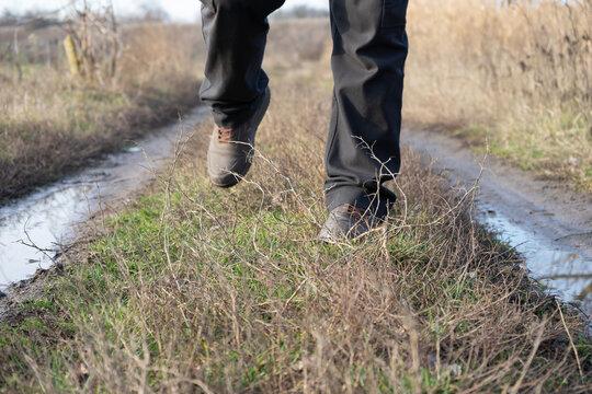 A tourist walks along a dirt road