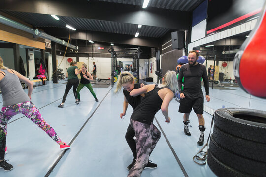 People practicing martial arts at gym
