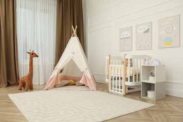 Obraz Cute baby room interior with crib and play tent - fototapety do salonu