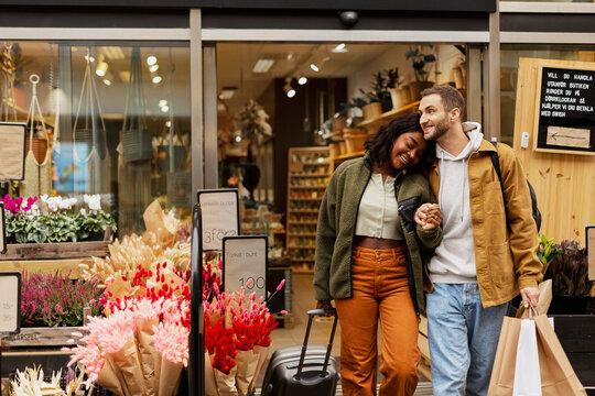 Happy couple leaving shop