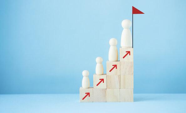 Successful leader wood block stacking as step stair.