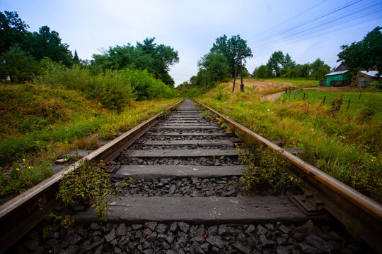 Railway in the mountains scenic views tourist route green landscape fluffy forest settlements Carpathians