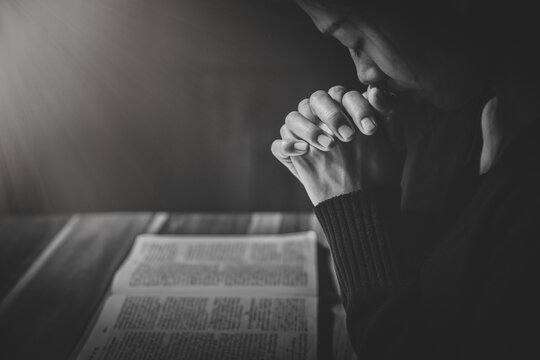 woman hands praying to god with the bible. Woman Pray for god blessing. Religious beliefs Christian life crisis prayer to god.