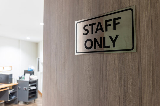 Warning sign in front of the door with a message for staff only with inside the sound control room.