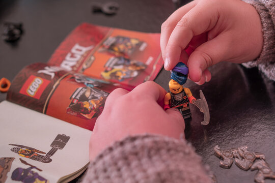 SANTA MARIA CAPUA VETERE, ITALY - Jan 30, 2021: Boy building a lego figures