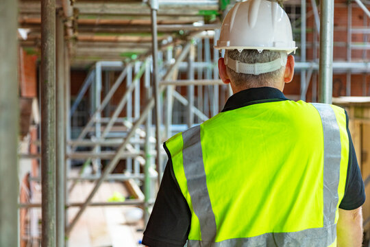 Rear View of a Construction Worker or Builder on Building Site