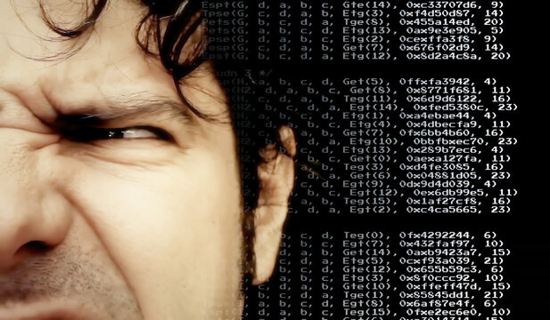 A bothered man's half face, looking at source code instructions scrolling on the screen (overimposition).
