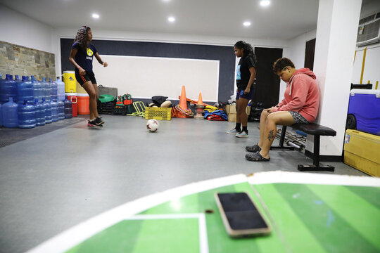 Deportivo Petare Futbol Club's player Yodanyeliz Palacios kicks a ball at team's sport house in Caracas