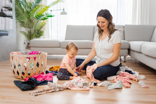 woman playing with her baby in the living room