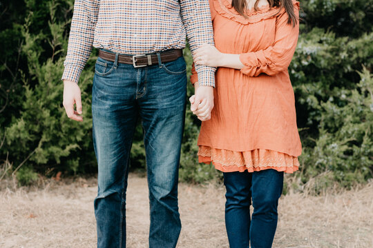 Shallow focus shot of a young couple standing side by side