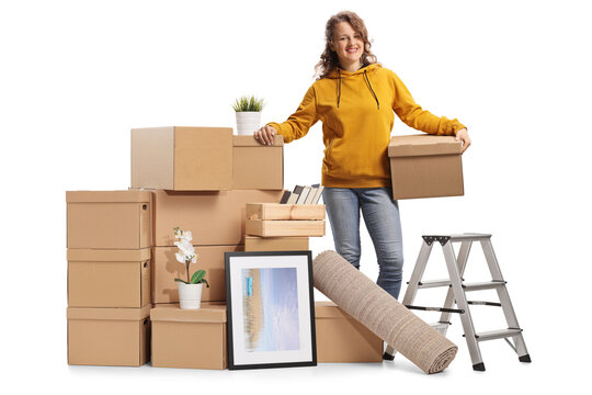Young female with a pile of cardboard boxes packed for removal