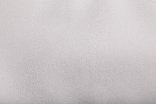 Texture of white leather, backround or backdrop, copy space.