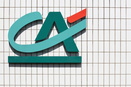 Champagne, France - August 15, 2019: Credit Agricole logo on a wall. Credit Agricole is a French network of cooperative and mutual banks comprising the 39 Credit Agricole Regional Bank