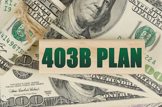 On the dollars is a wooden plate with the inscription - 403B PLAN