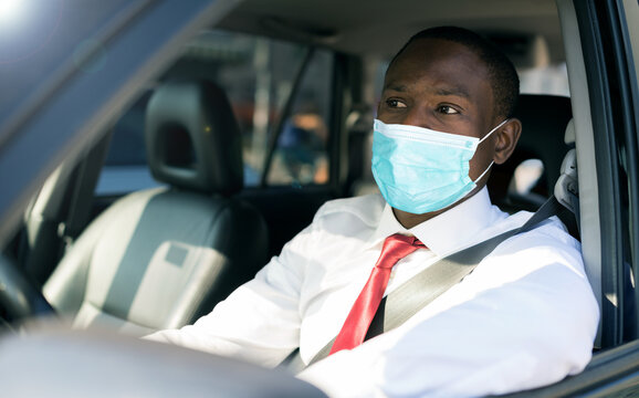 Businessman driving car, covid coronavirus concept
