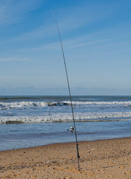Vendee, France; January 25, 2021: A casting fishing rod positioned on a beach in Bretignolles Sur Mer.