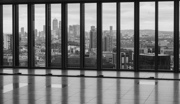 London skyline seen through ceiling high windows in an office building