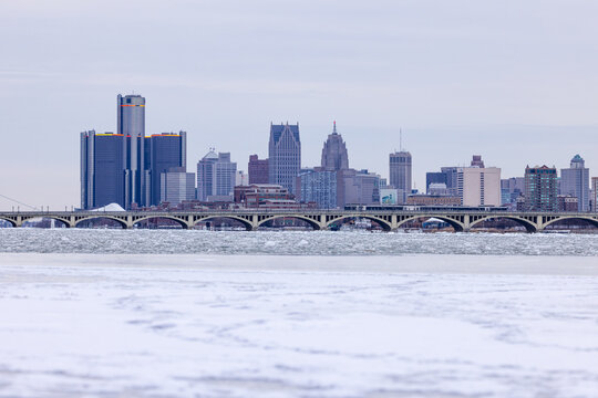 View from Belle Isle Park over downtown Detroit during winter time with frozen Detroit River.