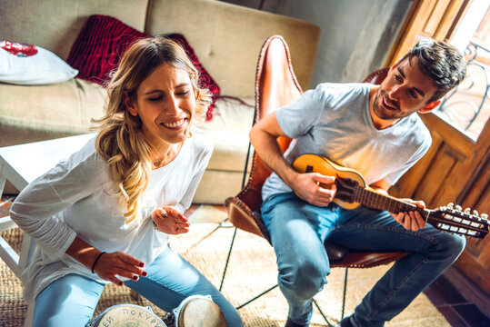 Sweet happy couple playing music