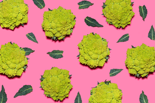 Pattern of Romanesco cauliflowers against pink background