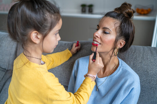 Mother and daughter putting makeup on each other in their week of joint custody, Spain