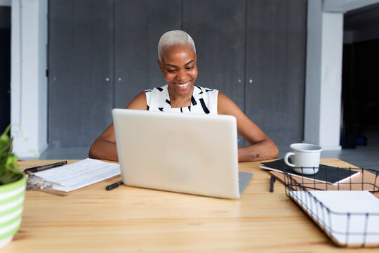 Spain Barcelona, african american woman working at office, mpdern african-american working female alone barcelona casual-office