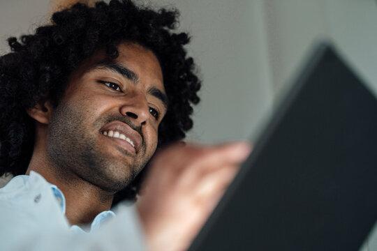 Smiling male healthcare worker using digital tablet at hospital