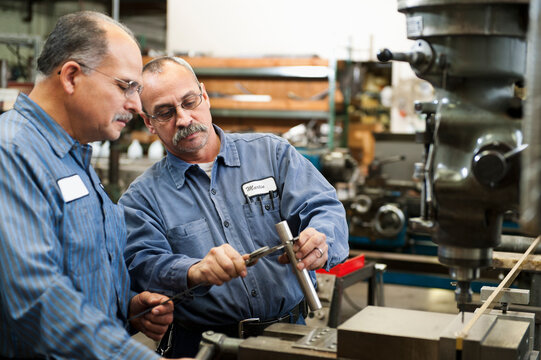 Skilled workers in factory