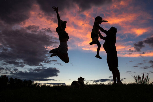 The happiness of three in the sunset