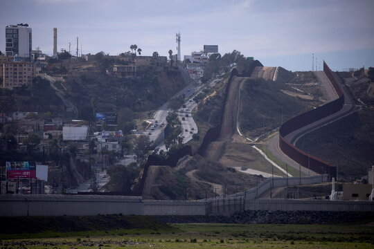 Tijuana, Mexico can be viewed on the left as assorted border walls and security between the U.S. and Mexico are shown from San Diego, California
