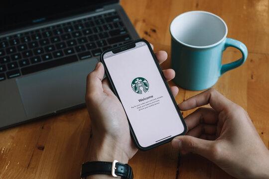 CHIANG MAI, THAILAND - JAN 23, 2021 : Starbucks app on the Apple iPhone display screen. opening online menu page of Starbucks website, Starbucks coffee shop.