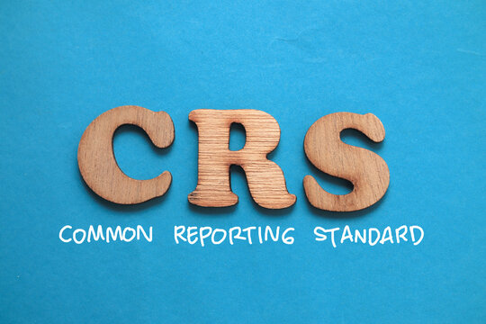 CRS Common Reporting Standard, text words typography written on blue background, life and business motivational inspirational