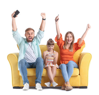 Happy family with mobile phones on sofa against white background