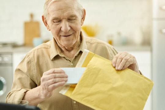 Elderly citizen unpacking his medicine mail order