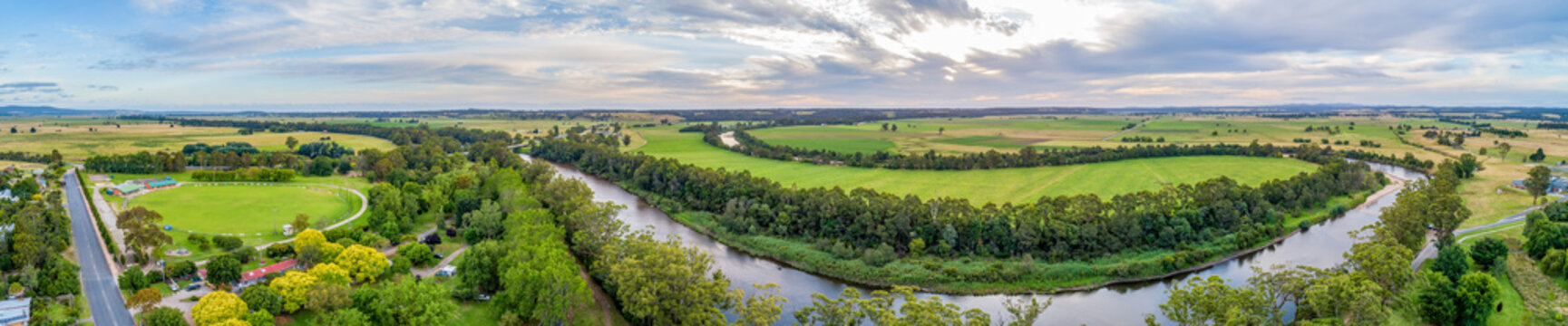 Wide aerial panoramic landscape of the Snowy River and fields in Victoria, Australia