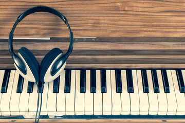 headphone on piano keys. music background