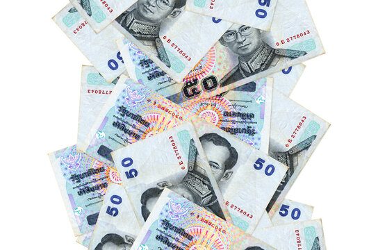 50 Thai Baht bills flying down isolated on white. Many banknotes falling with white copyspace on left and right side