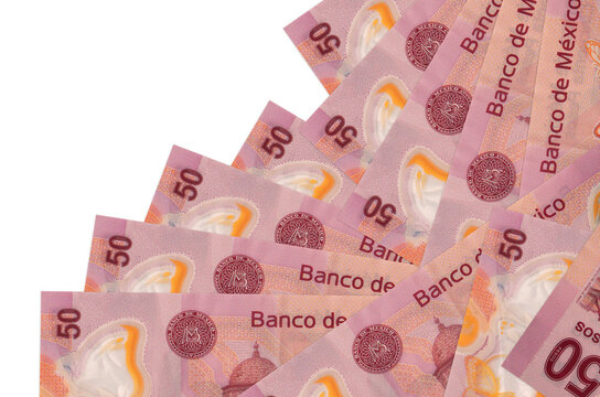 50 mexican pesos bills lies in different order isolated on white. Local banking or money making concept