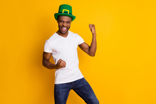 Portrait of his he nice attractive ecstatic cheerful cheery guy wearing festal hat celebrating attainment isolated over bright vivid shine vibrant yellow color background