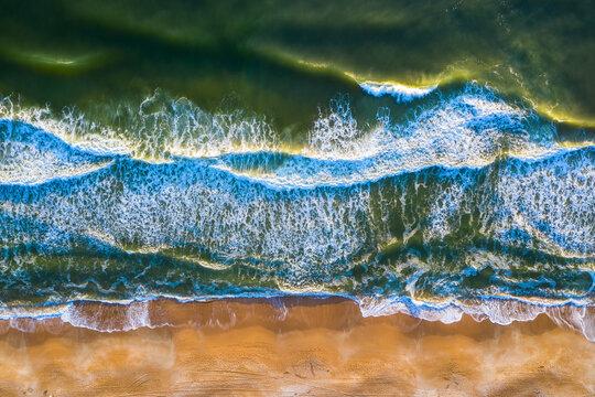 Aerial view of crispy waves of North Atlantic Ocean breaking on the sandy beach of Anastasia Island in Florida, United States of America