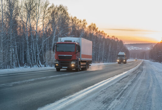 Trucks move in winter along country road