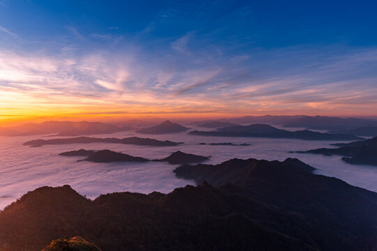 Landscape and starscape of the mountain and sea of mist in winter sunrise view from top of Phu Chi Dao mountain , Chiang Rai, Thailand