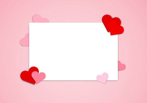 Red and pink heart paper and blank paper on pink background