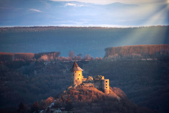 Somosko castle in border of Hungary and  Slovakia. Medieval Hngarian historical fortress ruins. Amazzing snowy view in winter.