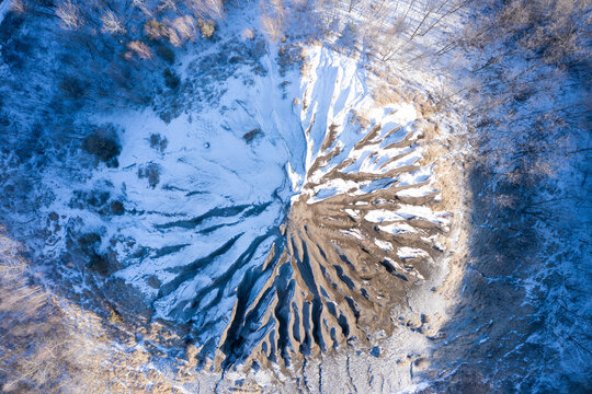 Amazing aerial  view of abandoned slag heap covered by snow and grass, winter landscape. Hungarian name is zagyvarónai salakkúp.
