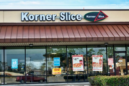 Humble, Texas USA 11-20-2019: Korner Slice Pizza storefront in Humble, TX. Freshly made gourmet pizzas, pastas, salads and subs are on the menu here.